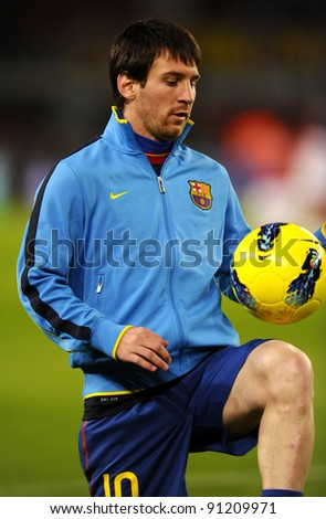 BARCELONA - NOV 29: Leo Messi of FC Barcelona playing with the ball  before the spanish league match against Rayo Vallecano at the Nou Camp Stadium on November 29, 2011 in Barcelona, Spain - stock photo