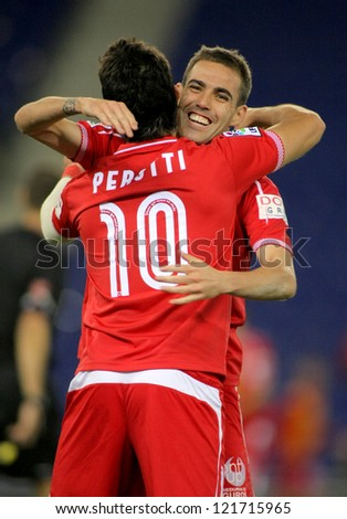 BARCELONA - NOV, 28: Perotti(L) & Navarro(R) of Sevilla celebrating goal during a King's Cup match between Espanyol and Osasuna  at the Estadi Cornella on November 28, 2012 in Barcelona, Spain - stock photo
