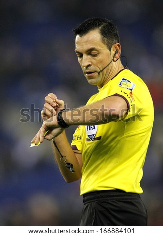 BARCELONA - NOV, 30: Referee Teixeira Vitienes check the time during a Spanish League match between RCD Espanyol vs Real Sociedad at the Estadi Cornella on November 30, 2013 in Barcelona, Spain - stock photo