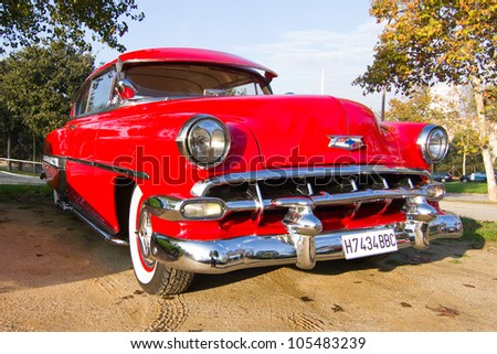 BARCELONA - NOVEMBER 12: A 1954 red Chevrolet Bel Air on display at a classic car show during Monster Jam Party, on November 12, 2011, in Olympic Stadium, Barcelona, Spain. - stock photo