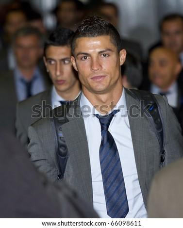 BARCELONA - NOVEMBER 28: Cristiano Ronaldo, player of Real Madrid C. F., arrive at Barcelona Airport. November 28, 2010 in Barcelona (Spain). - stock photo