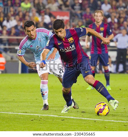 BARCELONA - NOVEMBER 1: Luis Suarez (R) of FCB in action at Spanish League match between FC Barcelona and Celta de Vigo, final score 0-1, on November 1, 2014, in Camp Nou stadium, Barcelona, Spain. - stock photo