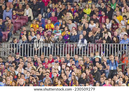 BARCELONA - NOVEMBER 1: Unidentified FCB supporters at Spanish League match between FC Barcelona and Celta de Vigo, final score 0-1, on November 1, 2014, in Camp Nou stadium, Barcelona, Spain. - stock photo