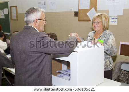 BARCELONA - NOVEMBER 9: Unidentified man votes in symbolic referendum on Catalonia independence, in defiance of the central government in Madrid, on November 9, 2014, in El Masnou, Barcelona, Spain.