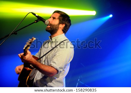 BARCELONA - OCT 10: Adam Olenius, vocalist of Shout Out Louds (band from Sweden), perfoms at Apolo stage on October 10, 2013 in Barcelona, Spain. - stock photo