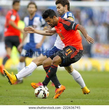 BARCELONA - OCT, 5: Carlos Vela of Real Sociedad in action during a Spanish League match against RCD Espanyol at the Estadi Cornella on October 5, 2014 in Barcelona, Spain - stock photo
