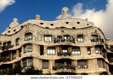 BARCELONA - OCT 14: Casa Mila in Barcelona, Spain, designed by architect Antoni Gaudi referred to as Catalan Modernisme  architecture in Barcelona on October 14, 2010 in Barcelona, Spain - stock photo