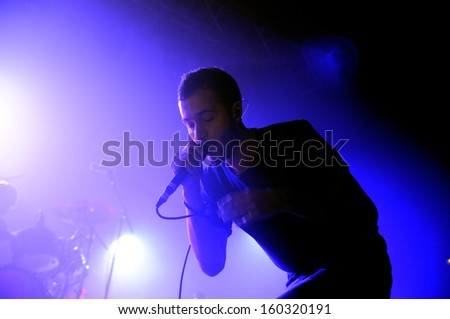 BARCELONA - OCT 19: Editors (British alternative rock band based in Birmingham) perfoms at Razzmatazz stage on October 19, 2013 in Barcelona, Spain. - stock photo