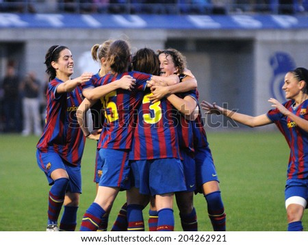 BARCELONA - OCT 31:: F.C Barcelona women's football team play against RCD Espanyol on October 31, 2009 in Barcelona, Spain. Superliga (Women's Football Spanish League) match. - stock photo