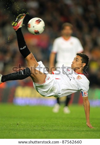 BARCELONA - OCT 22: Jesus Navas of Sevilla FC in action during the Spanish league match against FC Barcelona at the Nou Camp Stadium on October 22, 2011 in Barcelona, Spain - stock photo