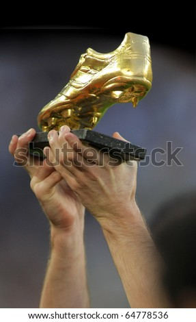 BARCELONA - OCT 3: Leo Messi hands with European Golden Boot award before spanish league match between FC Barcelona and RCD Mallorca at Nou Camp Stadium in Barcelona, Spain. October 3, 2010 - stock photo