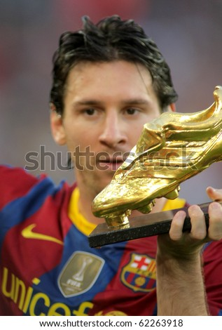 BARCELONA - OCT 3: Leo Messi of FC Barcelona with European Golden Boot award before Spanish league match between FC Barcelona and RCD Mallorca at Nou Camp Stadium in Barcelona, Spain. October 3, 2010 - stock photo