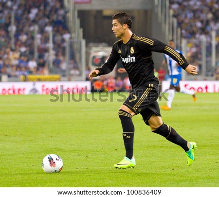 BARCELONA - OCTOBER 2: Cristiano Ronaldo in action during the Spanish League match between RCD Espanyol and Real Madrid, final score 0 - 4, on October 2, 2011 in Cornella stadium, Barcelona, Spain. - stock photo