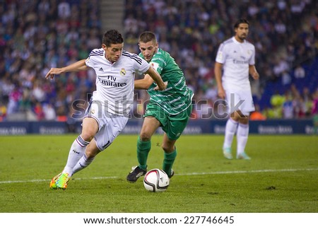 BARCELONA - OCTOBER 29: James Rodriguez of RM (L) in action at the Copa del Rey match between UE Cornella and Real Madrid, final score 1 - 4, on October 29, 2014, in Cornella, Barcelona, Spain. - stock photo