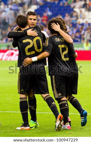 BARCELONA - OCTOBER 2: Madrid players celebrating a goal at the Spanish League match between RCD Espanyol and Real Madrid, final score 0 - 4, on October 2, 2011 in Cornella stadium, Barcelona, Spain. - stock photo