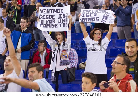 BARCELONA - OCTOBER 29: Real Madrid fans at the Copa del Rey match between UE Cornella and Real Madrid, final score 1 - 4, on October 29, 2014, in Cornella, Barcelona, Spain. - stock photo