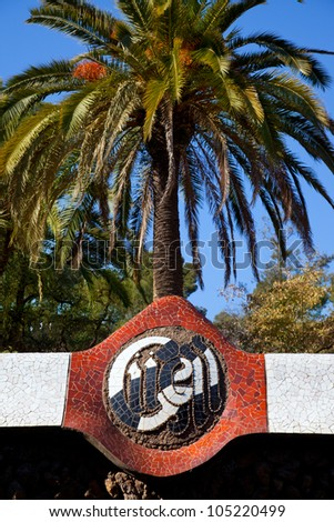 Barcelona Park Guell  name written in mosaic of Gaudi modernism - stock photo