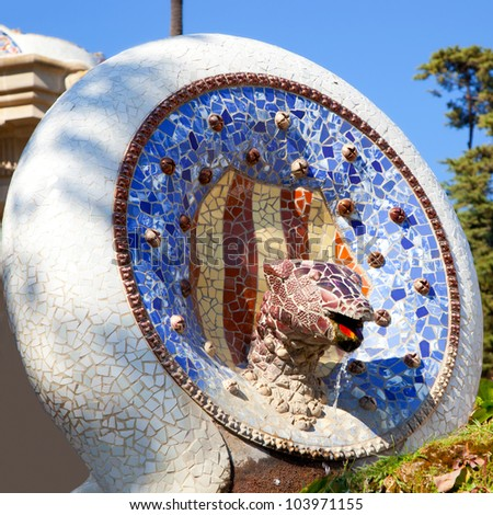 Barcelona Park Guell of Gaudi Snake and four Catalan bars in modernism mosaic - stock photo