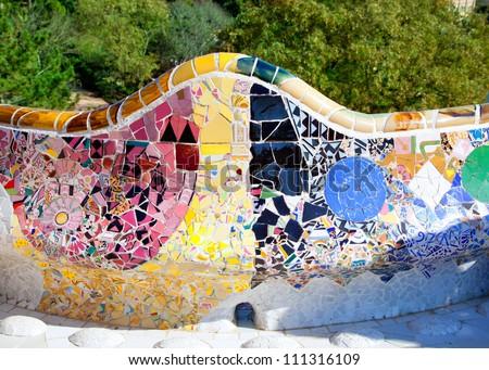 Barcelona Park Guell of Gaudi tiles mosaic serpentine bench modernism - stock photo