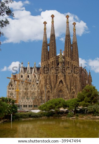 Barcelona's famous cathedral La Sagrada Familia which was started to be built-up in 1882. This image shows how beautiful it might look like without too many of all the scaffolding and cranes around. - stock photo