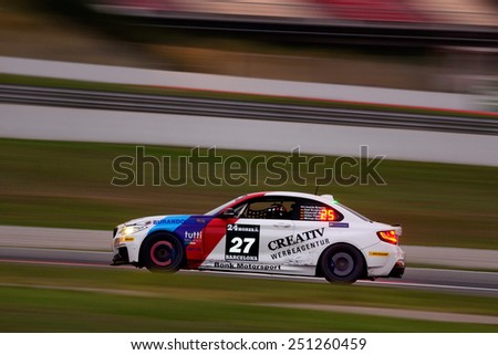BARCELONA, SAPIN - SEP 7: Team formed by Axel Burghardt, Liesette Braams and Michael Bonk races in a BMW M235i in the 24 Hours of Barcelona, at Catalunya Circuit, on Sep 7, 2014 in Barcelona, Spain. - stock photo