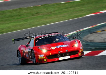 BARCELONA, SAPIN - SEP 7: Team formed by Jiri Pisarik, Matteo Malucelli and Peter Kox races in a Ferrari 458 GT3 in the 24 Hours of Barcelona, at Catalunya Circuit, on Sep 7, 2014 in Barcelona, Spain. - stock photo