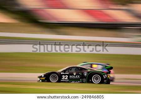 BARCELONA, SAPIN - SEP 7: Team formed by Jonathan Sicart and Dimitri Enjalbert races in a Ferrari 458 GT3 in the 24 Hours of Barcelona, at Catalunya Circuit, on Sep 7, 2014 in Barcelona, Spain - stock photo