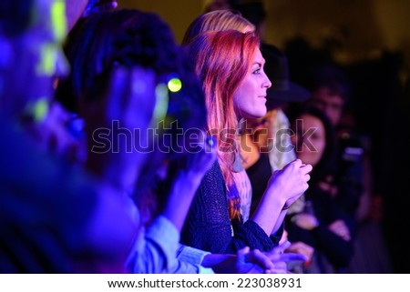 BARCELONA - SEP 23: Redhead woman from the audience applauding at Barcelona Accio Musical (BAM) La Merce Festival on September 23, 2014 in Barcelona, Spain. - stock photo