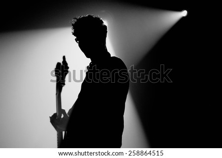 BARCELONA - SEP 24: Silhouette of the bass player of We are Standard (band) performs at Discotheque Razzmatazz on September 24, 2010 in Barcelona, Spain. - stock photo