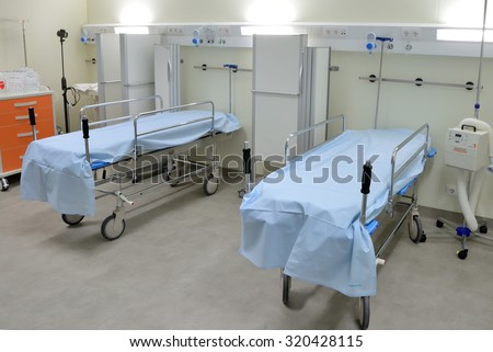 BARCELONA - SEP 22: Stretchers in the empty recovery room of an hospital on September 22, 2015 in Barcelona, Spain. - stock photo