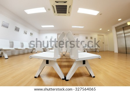 BARCELONA - SEP 22: Waiting room in a clinic with empty chairs on September 22, 2015 in Barcelona, Spain. - stock photo