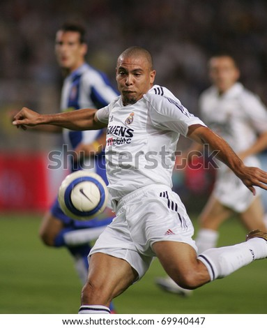 BARCELONA - SEPT 18: Brazilian player Ronaldo of Real Madrid in action during the match between Espanyol and Real Madrid at the Olympic Stadium on September 18, 2004 in Barcelona, Spain - stock photo
