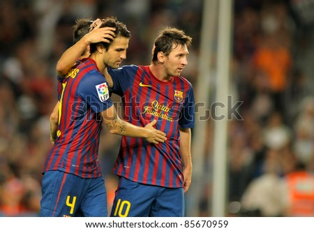 BARCELONA - SEPT, 17: Cesc Fabregas and Leo Messi of FC Barcelona celebrate goal during the spanish league match against Osasuna at the Nou Camp Stadium on September 17, 2011 in Barcelona, Spain - stock photo