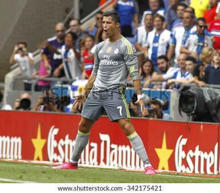 BARCELONA - SEPT, 12: Cristiano Ronaldo of Real Madrid celebrating a goal during a Spanish League match against RCD Espanyol at the Power8 stadium on September 12 2015 in Barcelona Spain - stock photo