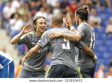 BARCELONA - SEPT, 12: Luka Modric(L) Pepe(C) and Gareth Bale(R) of Real Madrid during a Spanish League match against RCD Espanyol at the Power8 stadium on September 12 2015 in Barcelona Spain - stock photo