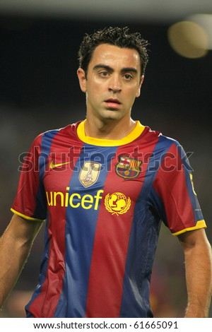BARCELONA - SEPT 22: Xavi Hernandez of Barcelona during Spanish league match between FC Barcelona and Sporting Gijon at Nou Camp Stadium in Barcelona, Spain. September 22, 2010 - stock photo