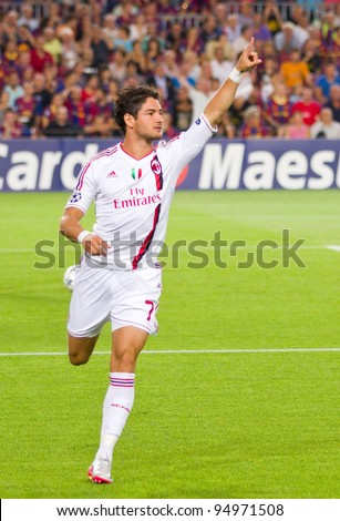 BARCELONA - SEPTEMBER 13: Alexandre Pato celebrating his goal during the Champions League match between FC Barcelona and AC Milan, final score 2 - 2, on September 13, 2011, in Barcelona, Spain. - stock photo