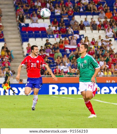 BARCELONA - SEPTEMBER 4: Chicharito Hernandez (14) of Mexico in action during the match between Mexico and Chile, final score 1 - 0, on September 4, 2011, in Cornella stadium, Barcelona, Spain.