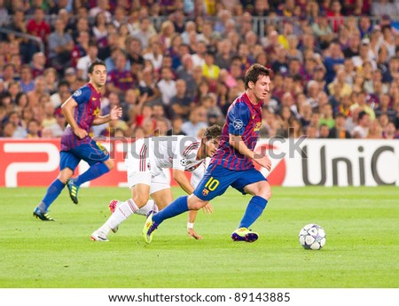 BARCELONA - SEPTEMBER 13: Leo Messi (R) in action during the UEFA Champions League match between FC Barcelona and AC Milan, final score 2 - 2, on September 13, 2011, in Barcelona, Spain. - stock photo