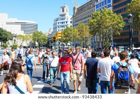 BARCELONA - SEPTEMBER 15: Many of tourists strolling across the center of the city on September 15, 2011 in Barcelona. It is one of the busiest pedestrian areas in Barcelona - stock photo
