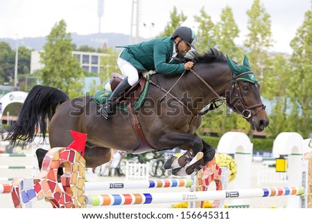 BARCELONA - SEPTEMBER 28: Ramzy Hamad Al Duhami from Saudi Arabia jumps an obstacle at CSIO - Furusiyya Nations Cup Horse Jumping Consolation Competition, on September 28, 2013, in Barcelona, Spain.