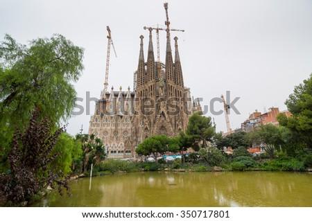 BARCELONA - SEPTEMBER 22: Sagrada Familia - Basilica and Expiatory Church of the Holy Family is a large Roman Catholic church in Barcelona, designed by Antoni Gaudi. Barcelona, Catalonia, Spain. - stock photo