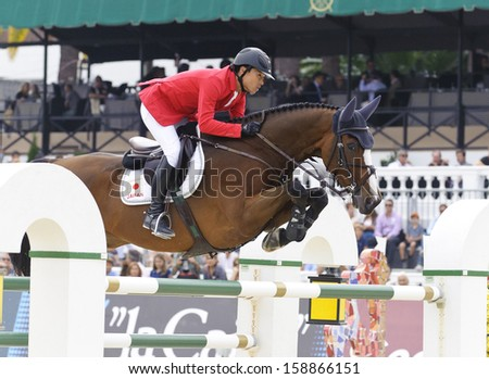 BARCELONA - SEPTEMBER 28: Taizo Sugitani rider in action during the Furusiyya Nations Final Cup in Real Club Polo Barcelona, on September 28, 2013, Barcelona, Spain.