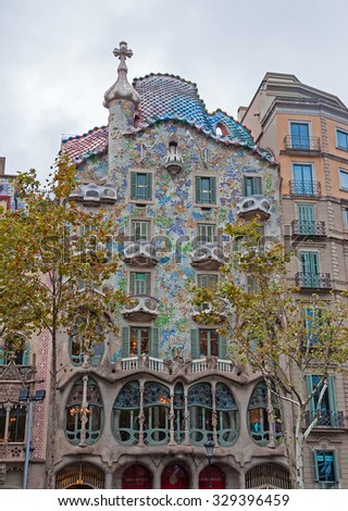 BARCELONA - SEPTEMBER 30, 2015: The facade of the house Casa Battlo (also could the house of bones) designed by Antoni Gaudi� with his famous expressionistic style - stock photo