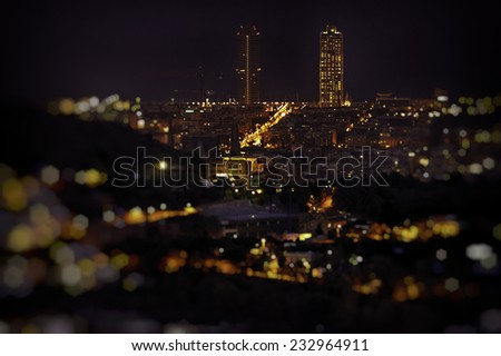 Barcelona skyline at night from mount of Tibidabo. - stock photo