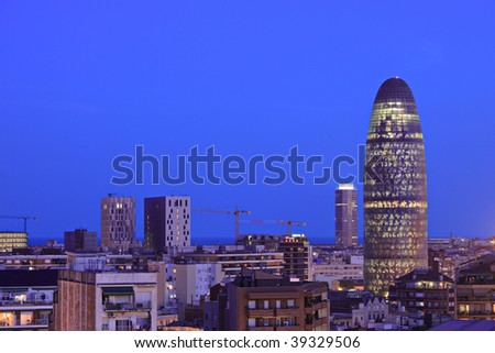 Barcelona skyline depicting Torre Agbar, Spain, by night - stock photo