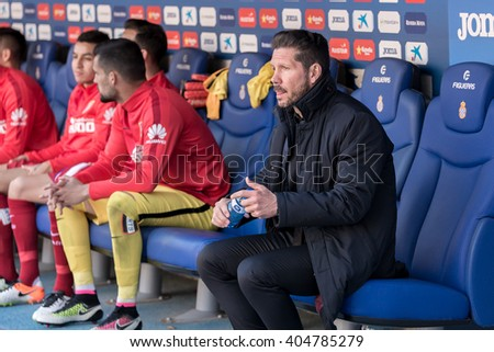 BARCELONA, SPAIN - APR 9: Diego Pablo ' El Cholo' Simeone sits on the bench at the La Liga match between RCD Espanyol and Atletico Madrid at the Powerade Stadium on April 9, 2016 in Barcelona, Spain.