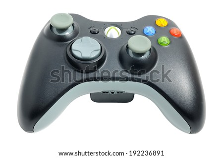 BARCELONA, SPAIN - APR 18, 2014: The wireless gamepad for the Xbox 360, a home video game console produced by Microsoft, isolated on white background. - stock photo