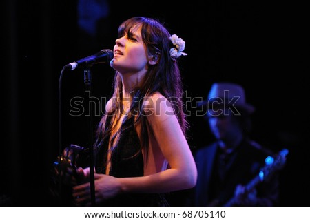 BARCELONA, SPAIN - APR 25: Zooey Deschanel, Hollywood Actress and singer, performs with her band She & Him at Apolo on April 25, 2010 in Barcelona, Spain. She performs with Matt Ward. - stock photo
