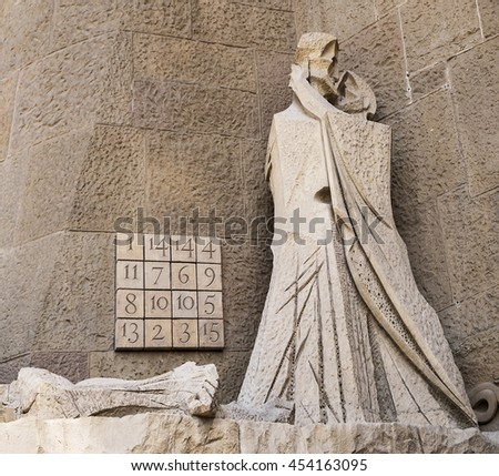 BARCELONA, SPAIN - APRIL 18, 2015: A scene on the Passion Facade of the Sagrada Familia portrays Judas kissing Jesus. Each line of the Subirachs Magic Square sums to 33 alluding to the age of Jesus. - stock photo